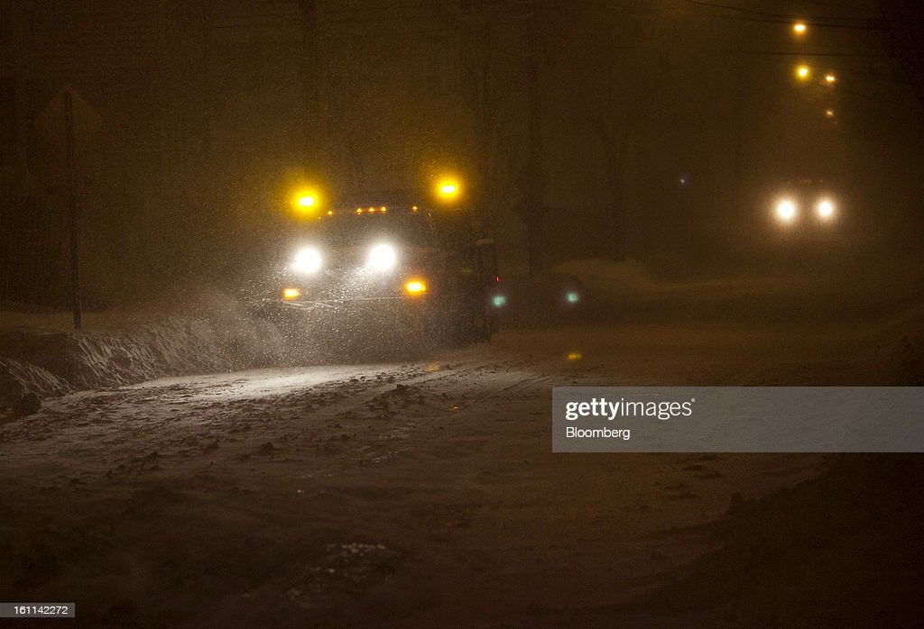 A snow plow clears Cedar Street during Winter Storm Nemo in Somerville, Massachusetts, U.S., on Friday, Feb. 8, 2013. More than two feet of snow fell on parts of the U.S. Northeast as high winds left hundreds of thousands of people in the region without power, closed highways and forced the cancellation of 4,700 flights. Photographer: Kelvin Ma/Bloomberg via Getty Images