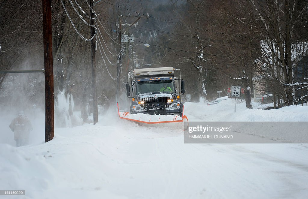 A snow plow clears road after a winter storm hit in Montague, Massachusetts, February 9, 2013. More than two feet (61cm) of snow fell on parts of the US Northeast as high winds left hundreds of thousands of people in the region without power, closed highways and forced the cancellation of some 4,700 flights. AFP PHOTO/Emmanuel Dunand