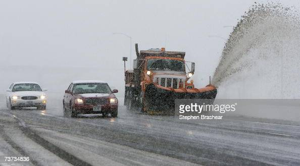 A snow plow clears snow from westbound Interstate 90 west of Billings Montana March 28 2007 Wyoming and Southeastern Montana is bracing for a spring...
