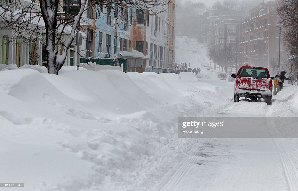 A snow plow drives down Brainerd Street after Winter Storm Nemo in Boston, Massachusetts, U.S., on Saturday, Feb. 9, 2013. More than two feet of snow fell on parts of the U.S. Northeast as high winds left hundreds of thousands of people in the region without power, closed highways and forced the cancellation of 4,700 flights. Photographer: Scott Eisen/Bloomberg via Getty Images