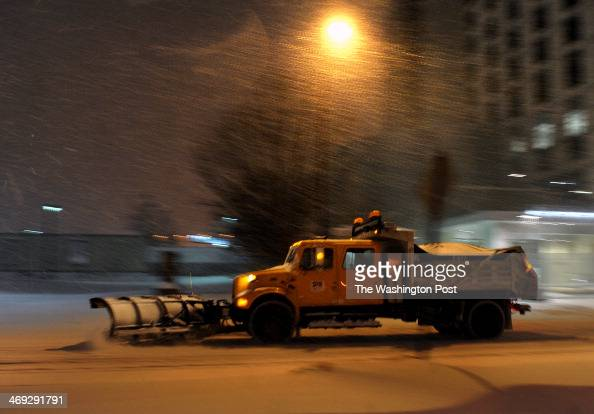 A snow plow makes its way on Georgia Ave in Wheaton in the predawn hours of Thursday The several inches of snow predicted to fall overnight turned...