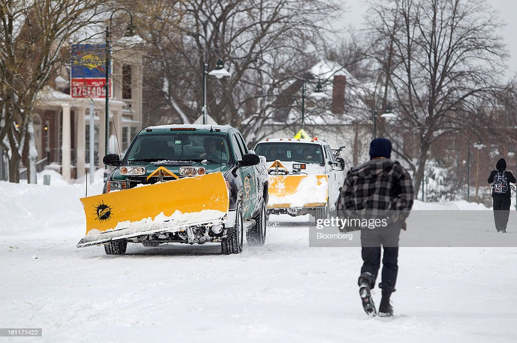 Snow plows drive down Harvard Street after Winter Storm Nemo in Brookline, Massachusetts, U.S., on Saturday, Feb. 9, 2013. More than two feet of snow fell on parts of the U.S. Northeast as high winds left hundreds of thousands of people in the region without power, closed highways and forced the cancellation of 4,700 flights. Photographer: Scott Eisen/Bloomberg via Getty Images