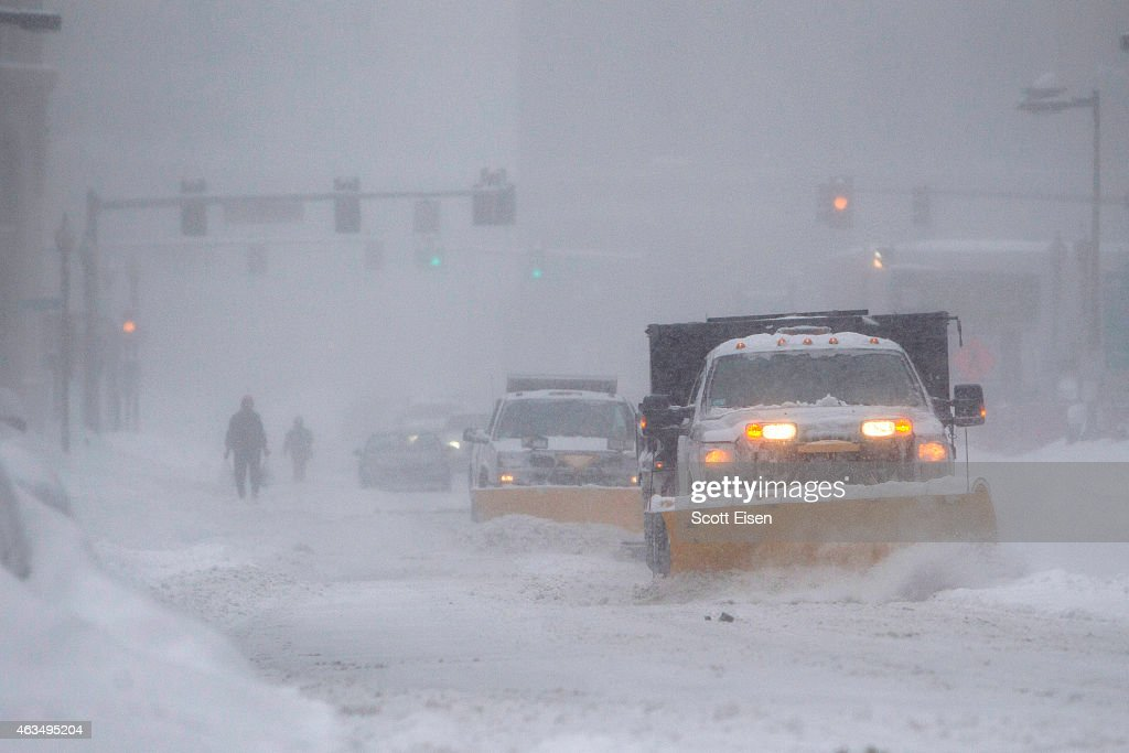 Snow plows make their way down Kneeland Stduring winter storm Neptune which dropped over a foot of snow February 15 2015 in Boston Massachusetts This...