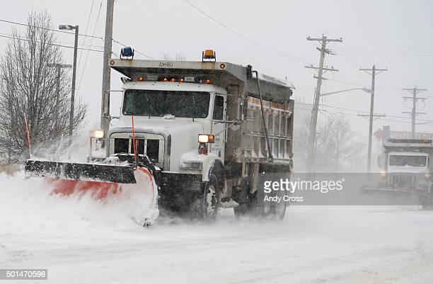 Snow plows work to clear Colorado Blvd near Yale Ave during a heavy snow storm December 15 2015