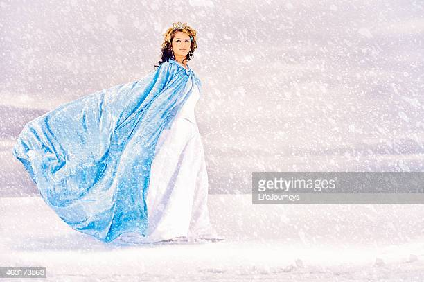 Snow Queen walking on a lake of ice while snow falls