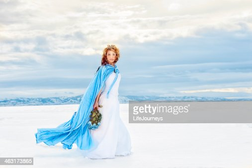 A snow queen walking on the lake