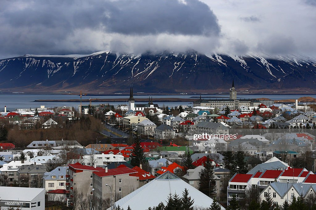 Snow remains on the top of mountains overlooking the Icelandic capital of Reykjavik on April 7 2014 in Reykjavik Iceland Since the financial meltdown...