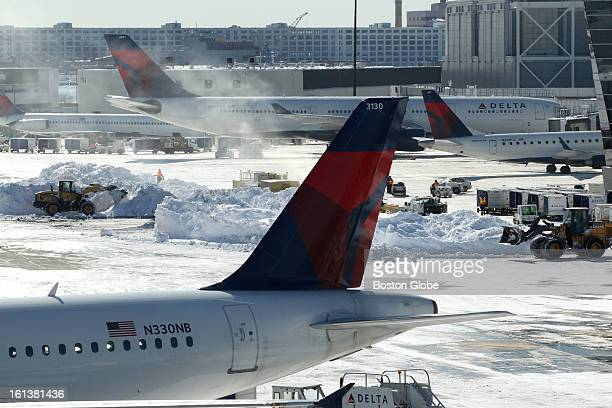Snow removal continues as Logan Airport is reopened for the first full day on Sunday February 10 after the blizzard