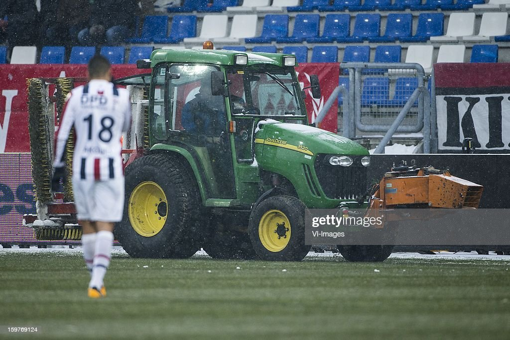 Snow remover on field during the Dutch Eredivise match between Willem II and ADO Den Haag at the Koning Willem II Stadium on January 20, 2013 in Tilburg, The Netherlands.