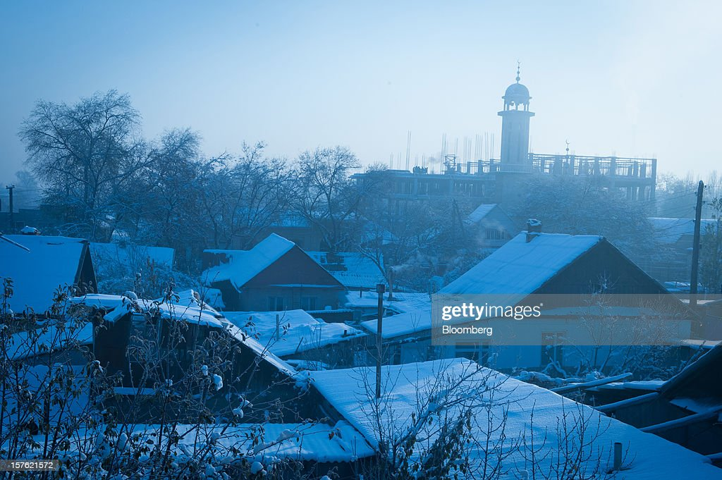 Snow rests on rooftops in Bishkek, Kyrgyzstan, on Thursday, Nov. 22, 2012. Landlocked Kyrgyzstan is the only country in the world that hosts both Russian and U.S. military bases. Photographer: Noriko Hayashi/Bloomberg via Getty Images