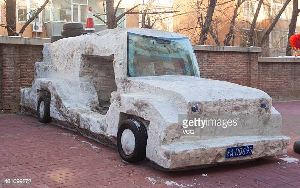 A snow sculpture of a car is seen on January 6 2015 in Changchun Jilin province of China Li Fengjiang a 56yearold driver built a snow sculpture of a...