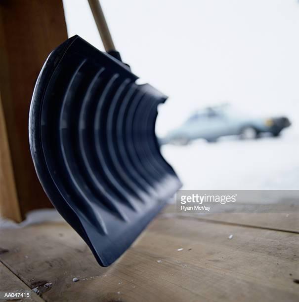 Snow Shovel on Porch of Winter Lodge