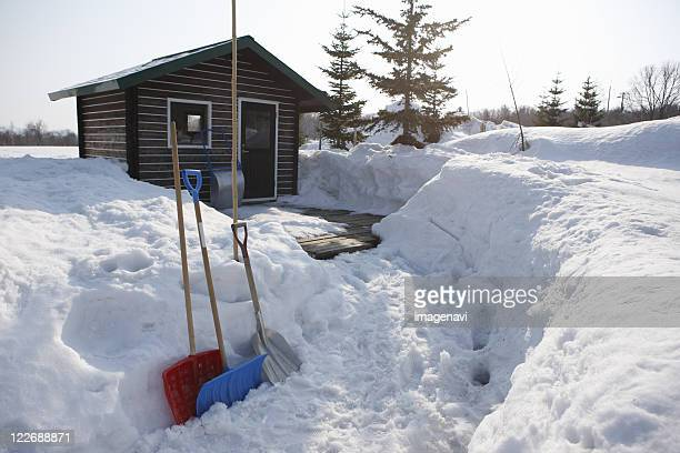 Snow shovels in front of cottage