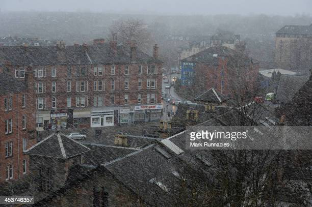 A snow shower sweeps through the city on December 5 2013 in Glasgow Scotland Parts of the UK have suffered winds of up to 142mph today causing travel...