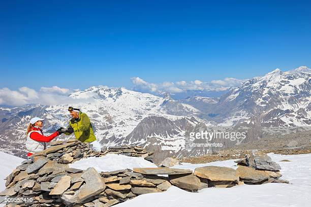 Snow skier couple in love at the top   Winter mountain