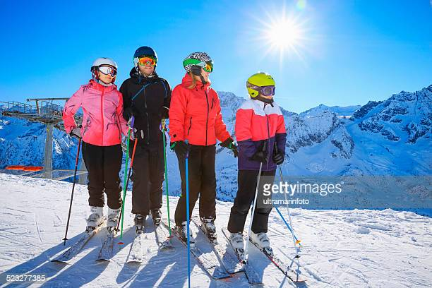 Snow skier family mother and father with children