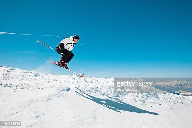 Snow skier jumping