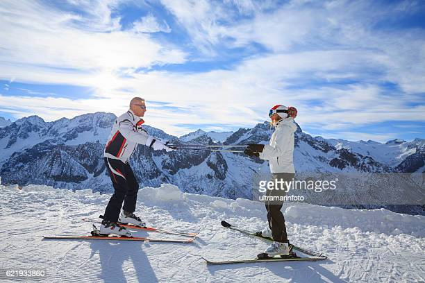 Snow skier women instructor teaching handsome man  Winter snowy mountains
