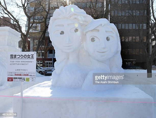 Snow statue of Elsa and Anna animation movie Frozen is seen during the 66th Sapporo Snow Festival at Odori Park on February 6 2015 in Sapporo Japan...