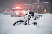 Snow storm in the city. Police car run on emergency call during snow storm in New York City.