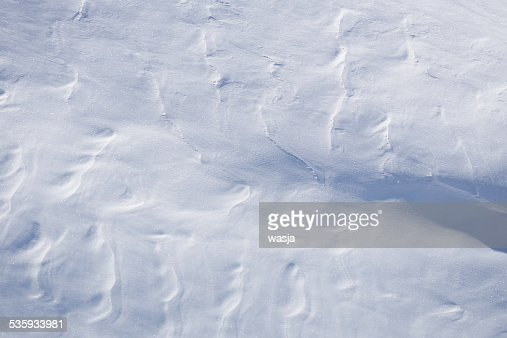 Snow texture, surface created by a wind : Stock Photo
