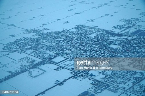 Snow town aerial view from airplane