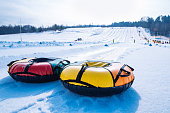 snow tubing. sleigh on the top of the hill. winter activity concept