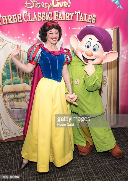 Snow White and Dopey attend The Moms Disney Live Mamarazzi event with Alana and Nicole Feld at Madison Square Garden on April 10 2015 in New York City
