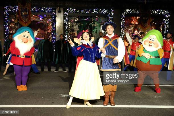 Snow White The Prince and the Seven Dwarfs perform during the 2017 Saks Fifth Avenue Holiday Window Unveiling And Light Show at Saks Fifth Avenue on...