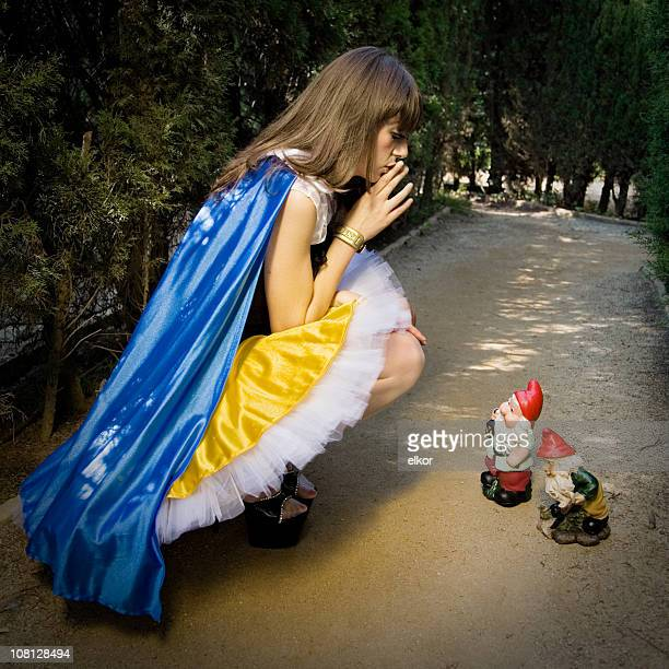 Snow White Whispering to Garden Gnomes on Pathway
