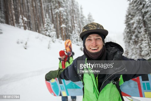 Snowboader laughing at a hike, during the winter. : Stock Photo