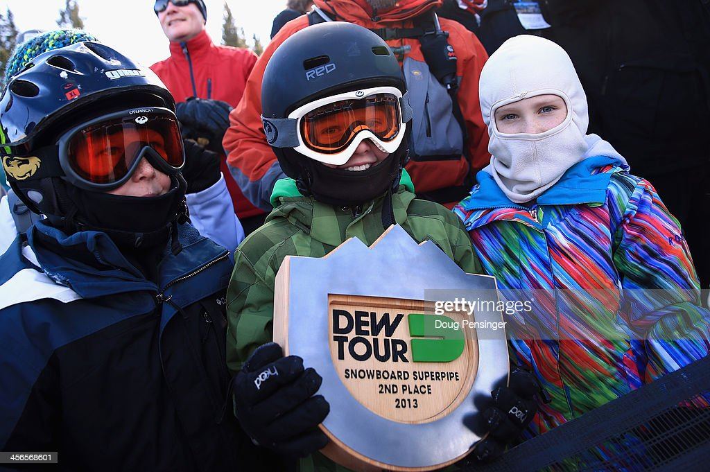 Snowboard fan Connor Tripp, 11, of Castle Rock, Colorado shows off his souvenir after Shaun White gave him his second place trophy following the men's snowboard superpipe final at the Dew Tour iON Mountain Championships on December 14, 2013 in Breckenridge, Colorado.
