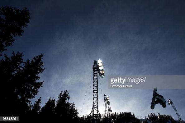 A snowboard performs a trick during the Snowboard Men's Halfpipe on day six of the Vancouver 2010 Winter Olympics at Cypress Snowboard SkiCross...