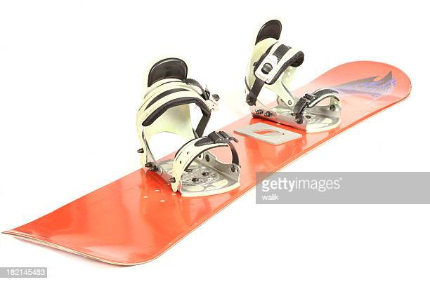 A snowboard with bindings against a white background