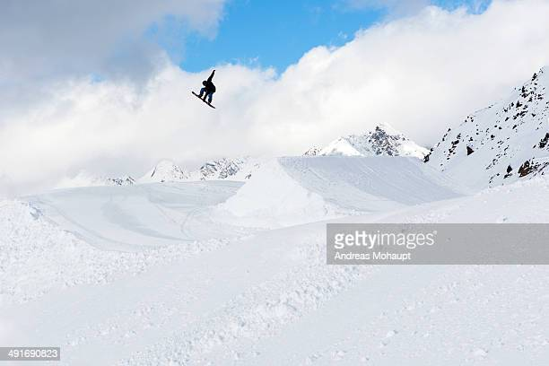 Snowboarder doing a trick in funpark