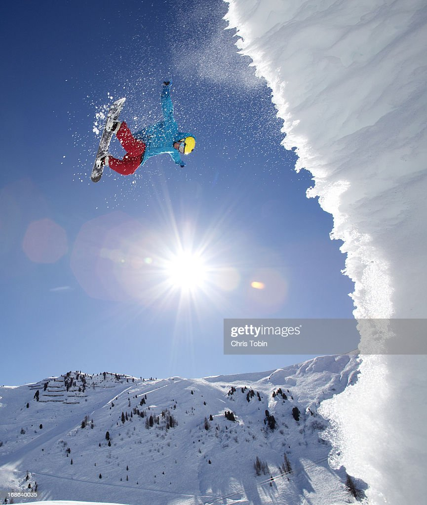 Snowboarder doing an awesome jump
