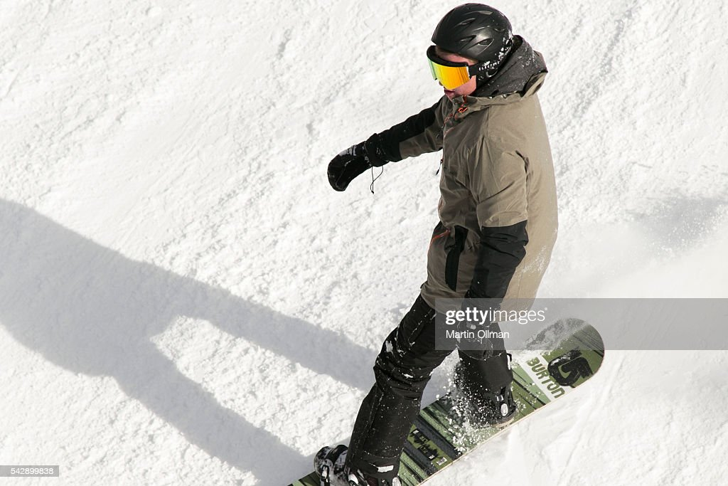 A snowboarder enjoys the fresh snowfall on the opening weekend of the season on June 25, 2016 in Thredbo Village Australia. Snow has been forecast across Eastern Australia as cold front continues to bring low temperatures, rain and potentially damaging winds.