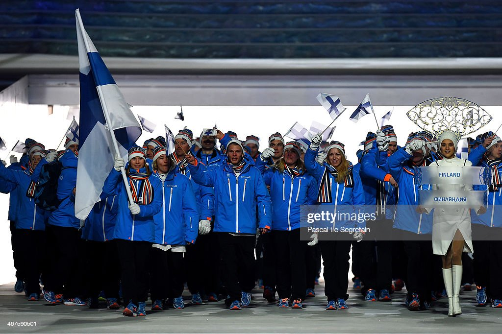 Snowboarder Enni Rukajarvi of the Finland Olympic team carries her country's flag during the Opening Ceremony of the Sochi 2014 Winter Olympics at Fisht Olympic Stadium on February 7, 2014 in Sochi, Russia.
