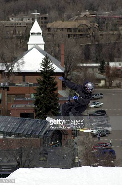 A snowboarder flies over the heights of Aspen Mountain ski area in Colorado April1 the first day snowboarders will be regularly allowed on the slopes...