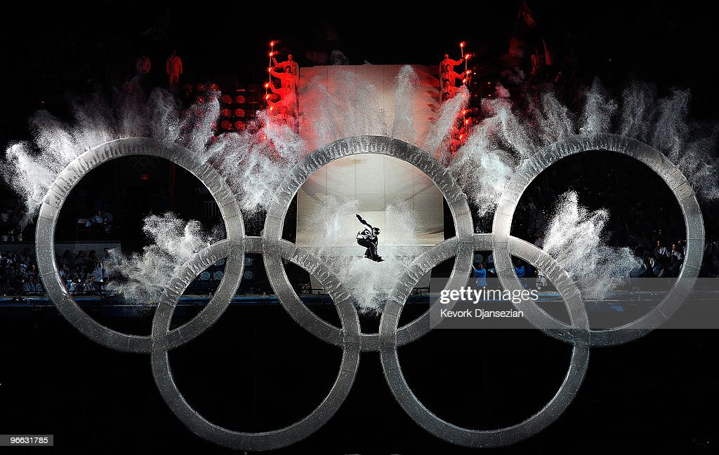 A snowboarder flies thru the Olympic Rings during the Opening Ceremony of the 2010 Vancouver Winter Olympics at BC Place on February 12, 2010 in Vancouver, Canada.