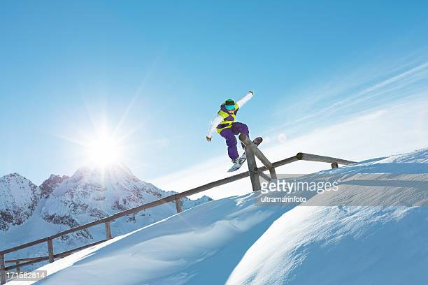 Snowboarder grinding