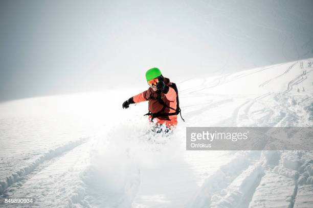 Snowboarder in Action in Fresh Powder Snow