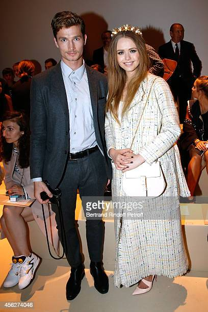 Snowboarder Iouri Podladtchikov and blogger Kristina Bazan attend the Akris show as part of the Paris Fashion Week Womenswear Spring/Summer 2015 on...
