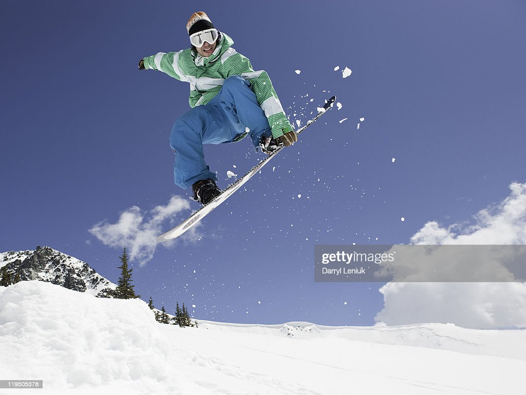 snowboarder jumping in air : Stock Photo