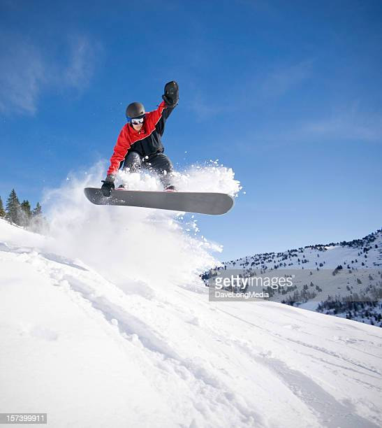 Snowboarder Jumping in Deep Snow