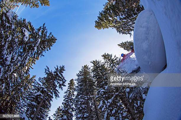 Snowboarder jumping off a cliff