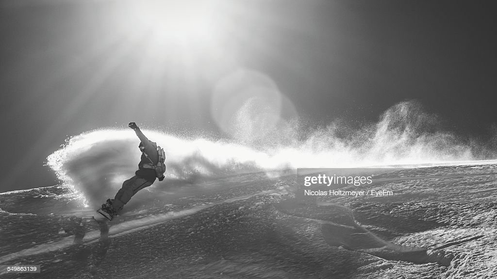 Snowboarder Jumps From Cliff Of Snow
