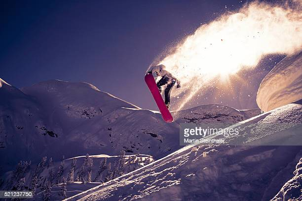 Snowboarder jumps into the sun