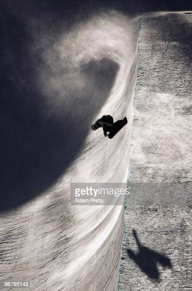 A snowboarder practices during snowboard training prior to the Turin 2006 Winter Olympic Games on February 9 2006 in Bardonecchia Italy The opening...