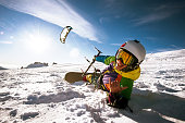 Bright color Snowboarder skydives on blue sky backdrop. Sheregesh, Siberia, Russia